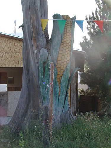 giant carved ear of corn from tree trunk