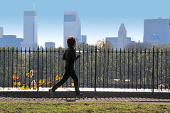 Jogging on a bright November morning (Ed Yourdon) Tags: newyork silhouette skyline fence centralpark manhattan reservoir jogging murray jogger citicorpcenter