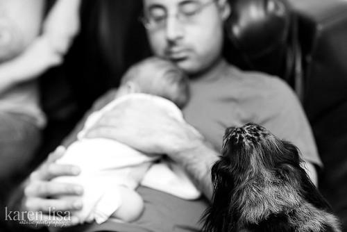 Maya watches Brij hold the baby