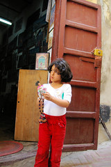 Little Moroccan Girl (cwgoodroe) Tags: ocean africa street old city sea summer people sun fish bus colors metal ferry plane children cafe sand ancient colorful doors artistic pentax vibrant muslim poor streetlife mosque arabic panasonic doorway morocco arab friendly moors conservative script casbah vegtable merchants continent merchant christians tangier monger moroccan tanger kasbah cleric sadfaces metaldoors fishmerchant casba casbha dailylifeportrait