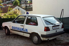 Cops ain't gonna catch much in that.  aPicture 199 (Cheese / Bob) Tags: old car vw golf republic police macedonia ohrid cop former fyrom yugoslavian