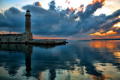 Sunrise (Theophilos) Tags: sea sky lighthouse reflection clouds sunrise crete rethymno