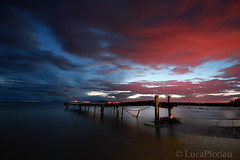 Crossover (LucaPicciau) Tags: sky seascape cold wet water misty night clouds canon landscape evening coast pond long mare quiet nuvola cloudy secret foggy cielo ethereal horror serene nothing void acqua molo placid damp sera endless ruggine crossover ferro passerella nuvoloso vuoto tenebre niente novole mistico picciau lucapicciau notteperspective