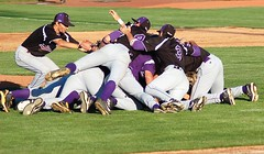After winning the state 3A championship for the second year in row, the Burns Hilander baseball team celebrates with a dogpile in the middle of the field at Volcanoes Stadium near Salem. Burns beat Westside Christian 11-8 on Friday, May 30. (Photo by DEBBIE�RANEY)