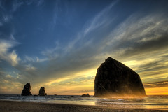 (Evan Snyder) Tags: ocean park sunset sea vacation sky mist color water silhouette clouds oregon bravo waves wildlife tide horizon d70s roadtrip stack explore pacificocean haystack cannonbeach haystackrock monolith preserve hdr imagery theneedles explored 3exp impressedbeauty