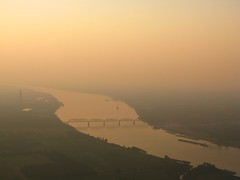 KY ( - ( IL (circulating) Tags: railroad bridge sunset summer sky orange water clouds river airplane evening illinois kentucky ky il hazy curve paducah tva aerialphotography ohioriver cnr barges coolingtowers canadiannationalrailway illinoiscentralrailroad icrr shawneefossilplant