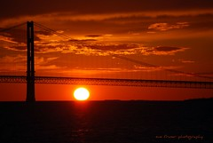 goodness gracious great balls of fire (suesue2) Tags: bridge sunset orange sun water michigan mackinacbridge suesue2 amazingmich vosplusbellesphotos thestraitsofmackinac
