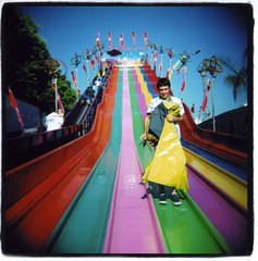 super slides (Claire Marie Vogel) Tags: california county pink blue red orange costa color green 120 film yellow analog square fun happy photo claire holga high colorful purple bright vibrant flash border vivid slide fair flags potato photograph medium format sack oc slides mesa colorflash vogel sloppy mikal cronin