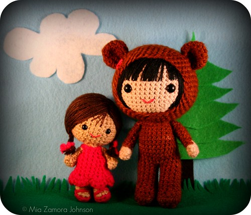 little girl & bigger bear costume girl