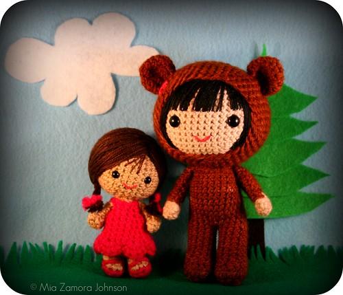 little girl & bigger bear costume girl