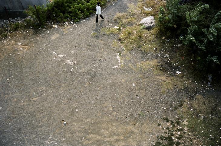 el_294 a woman walking in albania