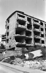 Grbavica War Destruction III (scurvy_knaves) Tags: bw film photography nikon war destruction sarajevo n50 bosniaandherzegovina grbavica