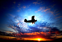 I Am On A 'High Flight' (TJ Scott) Tags: sunset silhouette dusk flight biplane skyascanvas lesamisdupetitprince