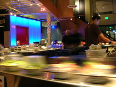 Sushi goes by on conveyor belt