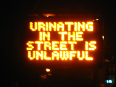 URINATING IN THE STREET IS UNLAWFUL (biondino) Tags: sign illuminated embankment peeing urinating