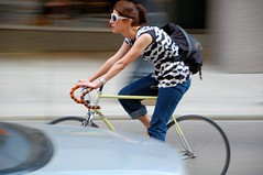 A touch of class (jeremyhughes) Tags: chicago motion blur sunglasses bicycle speed fix cycling movement nikon cyclist traffic shades explore jeans bracelet fixie fixedgear nikkor panning messengerbag stylish classy courierbag d40 jeremyhughes fixedwheel girlonabike nikond40 velocouture