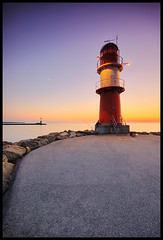 Baltic Sea | Rostock (Stephmaster) Tags: sunset sunlight lighthouse seascape beach water rock stone architecture strand port germany landscape evening coast warnemnde rocks wasser europa sailing sonnenuntergang harbour availablelight horizon himmel sigma wave steine 1020mm landschaft beacon dri hdr rostock horizont steilkste starboard felsen waterscape wellen langzeitbelichtung mecklenburgvorpommern wideangel longtimeexposure blauestunde 10mm weitwinkel portside eveningmood strmung tonemapping harbourentrance superweitwinkel navigationallight markgrafenheide hohedne mecklenburgwestpomerania ambientmood