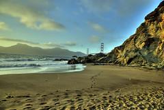 footprints in the sand (RCAGUIAT / Rodel Caguiat) Tags: ocean sanfrancisco bridge beach sand rocks waves footprints goldengate bayarea 1755mmf28g bakerbeach hdr nikond80