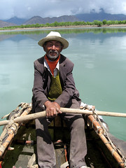 Tibetan Boatman on a Leather Boat (Namisan) Tags: yak lake leather boat tibet tibetan boatman leatherboat