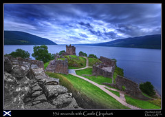 My trip to Scotland (4/20): 336 seconds with Castle Urquhart (with  !) (Klaus_GAP - taking a timeout) Tags: longexposure lake green castle geotagged scotland holidays stones ruin loch dramaticsky lochness nessie urquhart partialbw castleurquhart ilovescotland abigfave platinumphoto ultimateshot ysplix amazingamateur goldstaraward