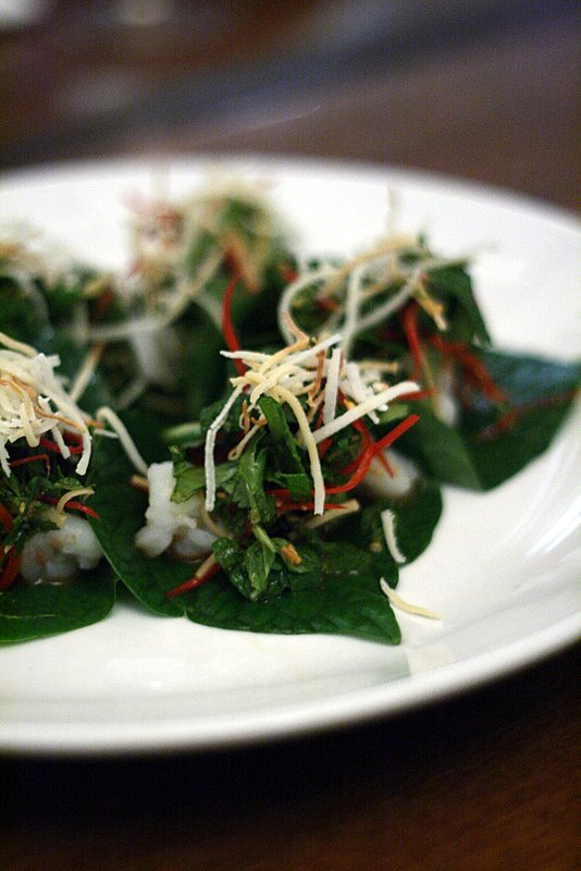Betel leaf topped with prawn, roasted coconut, mint and chilli