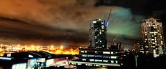 grand final eve (mugley) Tags: city sky urban architecture night clouds digital buildings construction nikon apartments cityscape australia melbourne victoria cranes atlantis flare cropped ghosts dslr nocturne urbanlandscape coles spencerst theage d300 dfo cityside westendplaza mondriane docksidetower tokina1224mmf4atxpro tokinaaf1224mmf4