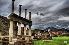 Pompeii - The Forum (` Toshio ') Tags: street italy storm building history colors grass clouds walking volcano alley ruins rocks europe italia roman forum bricks gray columns perspective vivid stormy tourists walkway mountvesuvius pompeii vesuvius soe hdr europeanunion 79ad eruption toshio highdynamicresolution colorphotoaward aplusphoto theunforgettablepictures