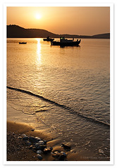 Fishing boats at Sunrise (Christos Andronis) Tags: travel light sea summer vacation beach water colors yellow sunrise canon landscape 350d dawn holidays rocks mani greece fishingboat peloponnese ελλάδα παραλία τοπίο θάλασσα νερό κίτρινο πελοποννησοσ σκουτάρι gettyimagesgreece1