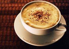 Cappuccino With Commercial Touch (Mashael Al-Shuwayer) Tags: food cup coffee digital canon eos 50mm cafe drink cream creme saudi arabia cappuccino alkhobar 400d mashael alshuwayer