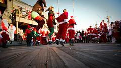 jumprope santas (sgoralnick) Tags: santa christmas xmas nyc costumes newyork jump jumping southstreetseaport santacon gothamist jumprope santarchy santaconnyc santacon2008