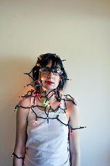 (morgan.laforge) Tags: portrait girl glasses christmaslights lipstick wifebeater