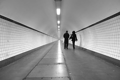 Tunnel to Infinity (fluxxus1) Tags: street city winter light shadow fab people urban blackandwhite bw woman white abstract black cold art texture monochrome lines silhouette wall architecture night composition underground walking point geotagged lumix grey lights europe solitude nightshot angle belgium geometry path infinity horizon perspective corridor streetphotography tunnel streetscene symmetry minimal panasonic explore silence convergence streetphoto minimalism passage vanishing emptiness antwerpen linear blackdiamond decisivemoment endless streetshot abigfave bwgallery platinumphoto lx3 anglesanglesangles overtheexcellence artinbw lumixaward theperfectphotographer bwartaward world100f spiritofphotography phvalue