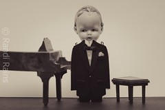 Piano recital. (Randi Rains Johnson) Tags: life musician music baby cute vintage hair fun toy miniature still doll child play antique fat small piano formal bisque norman creepy suit belly curly german tiny chubby dapper