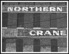 Northern Engineering Works Building (NORTHERN CRANE)--Detroit MI (pinehurst19475) Tags: old city urban blackandwhite bw building brick texture facade blackwhite industrial noiretblanc crane michigan bricks detroit commercial atwater weathered palimpsest northern rivertown brickwork paintedbrick foundtypography puredetroit blackandwhitephotos paintedover chene repainted blackwhitephotos blackandwhiteversion northernengineeringworks northernengineeringworksbuilding northernengineering pinehurst19475 northerncrane cheneandatwater