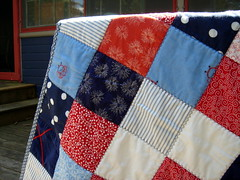 close up of blue red patchwork quilt