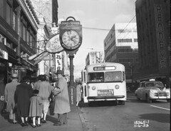 City bus, 1953 (Seattle Municipal Archives) Tags: seattle clock buses 1950s transportation publictransport streetscenes downtownseattle streetclock busstops streetclocks seattlemunicipalarchives