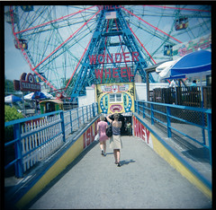 Sonja, Mercedes & the Wonder Wheel (Squid Ink) Tags: newyorkcity brooklyn coneyisland mercedes holga gothamist sonja summer08
