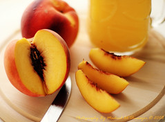 Peach.. (Mashael Al-Shuwayer) Tags: world red food yellow digital canon eos 50mm juice peach saudi arabia 400d mywinners mashael alshuwayer