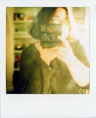 hi. (erin power) Tags: light reflection film self polaroid sx70 2008 blend