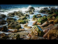Painted Rocks (...-Wink-...) Tags: ocean california blue sky beach nature water landscape coast harbor sand waves scenic bluesky explore shore vista thegimp soe ventura scapes topaz venturaharbor lumixdmcfz8 goldstaraward