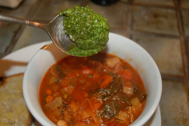 Minestrone soup with a dollop of fresh basil pesto