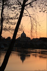 st peter's basilica at sunset (ana_lee_smith) Tags: sunset sky italy rome reflection tree water silhouette architecture river dome genius baroque riverbank stpeterssquare liquid bernini masterpiece michaelangelo stpetersbasilica vaticancity tiberriver ponteumberto michaelangelosdome abigfave anawesomeshot analeesmith onetinybirdforily itwouldwasnicetomeetyouinrome