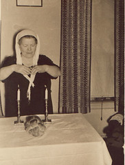 Bubbi Blessing Challah, Brooklyn, c 1940 (Lanterna) Tags: brooklyn bread familyhistory candles grandmother prayer religion bubbie blessing 1940s jewish esther ritual judaism sabbath lanterna ester judaica bubbe bubby fridaynight challah