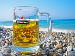 Sea+Beer = Summer (jimiliop) Tags: blue sea summer distortion beach water beer glass sunshine heineken happy nice waves stones relaxing greece positive through feeling soe goodtimes flickrsbest bej mywinners aplusphoto goldstaraward stunningphotogpin