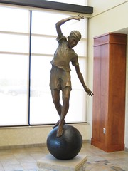 "Title: ""Keep the Ball Rolling""Sculptor: Jane DedeckerAccessible to Public: Yes, indoorsLocation: Northfield Hospital FoyerOwnership: Northfield HospitalMedium: BronzeDimension: 8 feet high.Provenance: Loveland, ColoradoYear of Installation: 2003Physical Condition: Good"