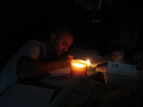 Beau doing homework by candle light
