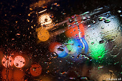 Rainy night (kavan.) Tags: blue light red orange color green glass rain night canon colorful sigma drop rainy 1770 kavan 400d