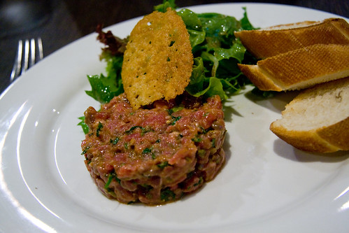 Beef tartare served with mesclun and Parmesan crisp (by P3rSeUs)