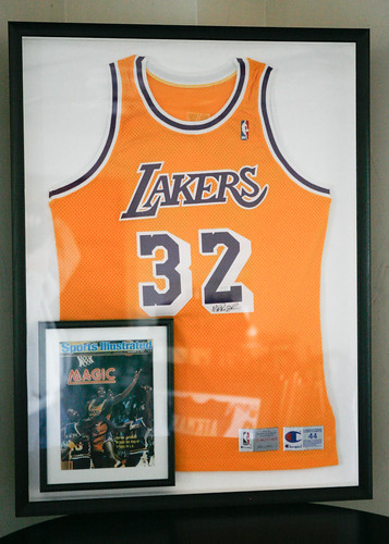 autographed magic johnson jersey in black frame