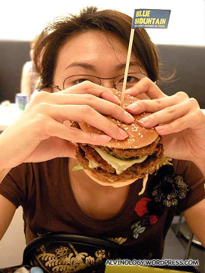 Rachel wolfing down a Blue Mountain burger